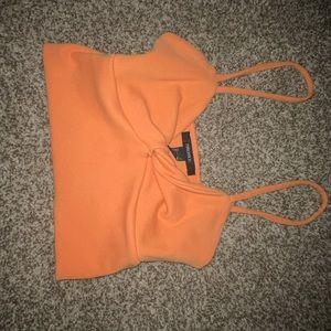 Orange knot crop top